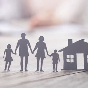 cutouts of family in front of home representing home insurance